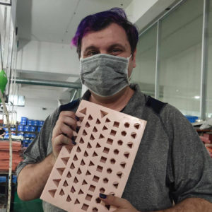 Resin dice mold in a factory